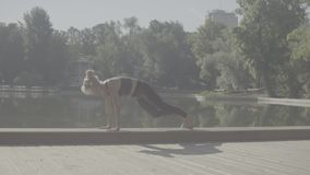 Young woman doing yoga asana - virasana stock video footage