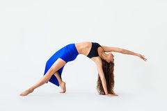 Young woman doing yoga asana Wild Thing Pose Royalty Free Stock Image