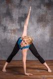 Young woman doing yoga asana Stock Images