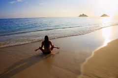 Young woman doing yoga at the beach Royalty Free Stock Photo
