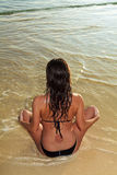 Young woman doing yoga at the beach Stock Images
