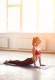 Young woman doing yoga cobra pose Royalty Free Stock Photography