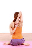Young woman doing YOGA cow face pose Royalty Free Stock Photo