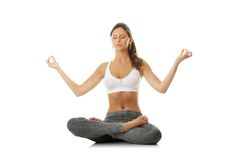 Young woman doing yoga exercise. Isolated on white Stock Photos