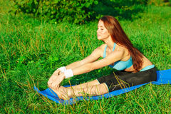 Young woman doing yoga exercise Royalty Free Stock Photography