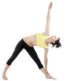 Young woman doing yoga exercise Stock Photos
