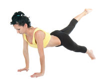 Young woman doing yoga exercise Stock Photos