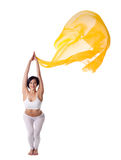 Young woman doing yoga exercise and flying veil Royalty Free Stock Images