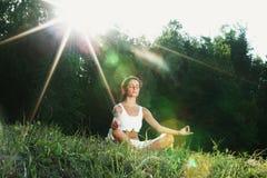 Young woman doing yoga exercise stock image