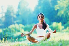 Young woman doing yoga exercise Royalty Free Stock Images