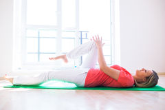 Young woman doing YOGA exercise at home Royalty Free Stock Image