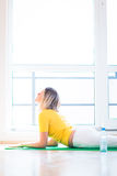 Young woman doing YOGA exercise at home. Pretty young woman doing YOGA exercise at home Royalty Free Stock Photo