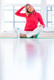 Young woman doing YOGA exercise at home Stock Photo