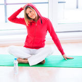 Young woman doing YOGA exercise at home Stock Photos