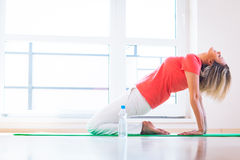 Young woman doing YOGA exercise at home Stock Images