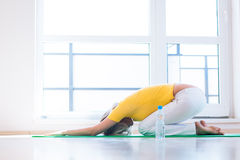 Young woman doing YOGA exercise at home Royalty Free Stock Photos