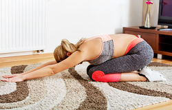 Young woman doing yoga exercise at home Royalty Free Stock Photo