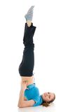 The young woman doing yoga exercise isolated Stock Photo