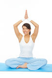 Young woman doing yoga exercise on mat. Portrait of fit young woman doing yoga exercise, isolated on white Stock Image