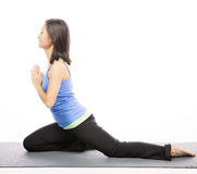 Young woman doing yoga exercise on mat Royalty Free Stock Image