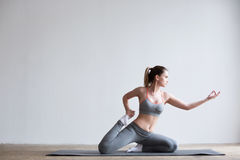 Young woman doing yoga exercise on mat. Yoga / Fitness / Health Royalty Free Stock Photography