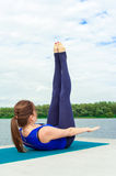 Young woman doing yoga exercise on mat 11 Royalty Free Stock Photo
