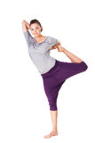 Young woman doing yoga exercise Natarajasana (Lord of the Dance. Pose). Isolated on white background Royalty Free Stock Photos