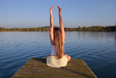 young woman doing yoga exercise outdoors Stock Image