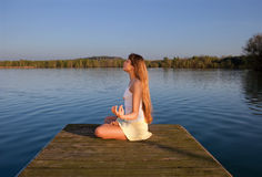 Young woman doing yoga exercise outdoors Royalty Free Stock Image
