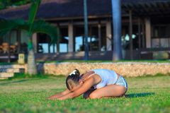 Young woman doing yoga exercise outdoors Royalty Free Stock Photo