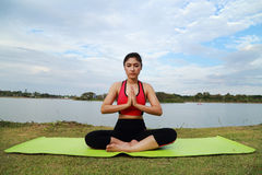 Young woman doing yoga exercise Royalty Free Stock Photos