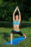 Young woman doing yoga exercise on park Royalty Free Stock Photography