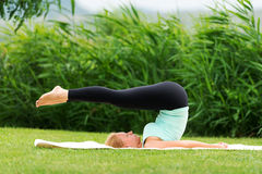 Young woman doing yoga exercise Royalty Free Stock Image