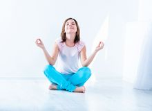 Young woman doing yoga exercise Stock Photography