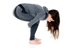 Young woman doing yoga exercise, squat position. Young woman doing yoga exercise squat position, isolated on white Stock Images