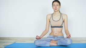 Young woman doing yoga exercise standing still and testing their endurance smile in camera. Young woman doing yoga exercise standing still and testing their stock footage