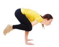 Young woman doing yoga exercise. On a white background royalty free stock images