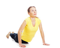 Young woman doing yoga exercise. On a white background stock images
