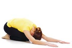 Young woman doing yoga exercise Stock Photo