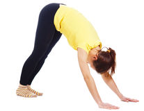 Young woman doing yoga exercise. On a white background stock image