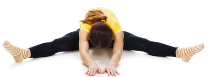 Young woman doing yoga exercise. On a white background stock photography