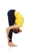 Young woman doing yoga exercise. On a white background royalty free stock photos