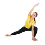Young woman doing yoga exercise. On a white background royalty free stock image