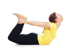 Young woman doing yoga exercise. On a white background royalty free stock photography
