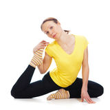 Young woman doing yoga exercise. On a white background stock photo