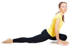 Young woman doing yoga exercise. On a white background stock photos
