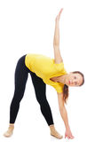 Young woman doing yoga exercise. On a white background royalty free stock photo