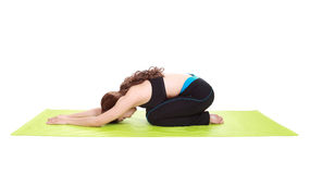 Young woman doing yoga exercise with yoga mat Royalty Free Stock Images