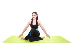 Young woman doing yoga exercise with yoga mat Stock Images