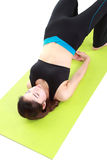 Young woman doing yoga exercise with yoga mat Stock Photos